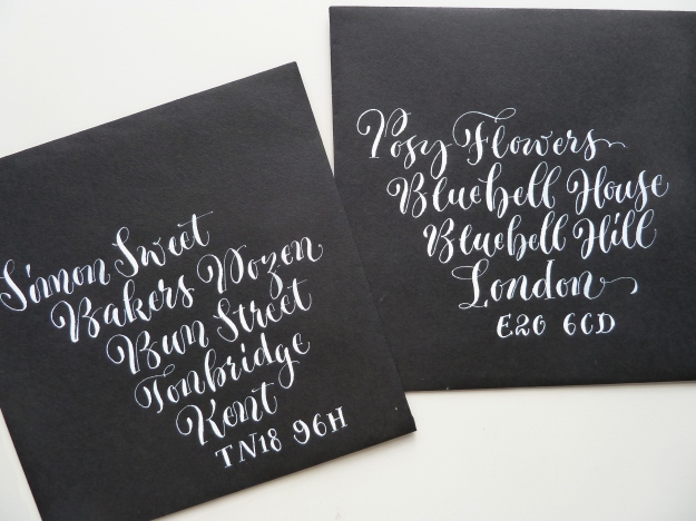 white-quirky-calligraphy-on-black-envelopes-uk