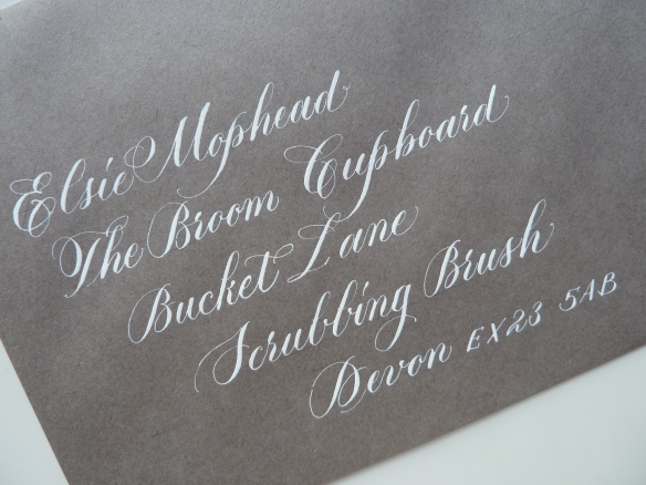 white-copperplate-calligraphy-on-grey-envelope-uk
