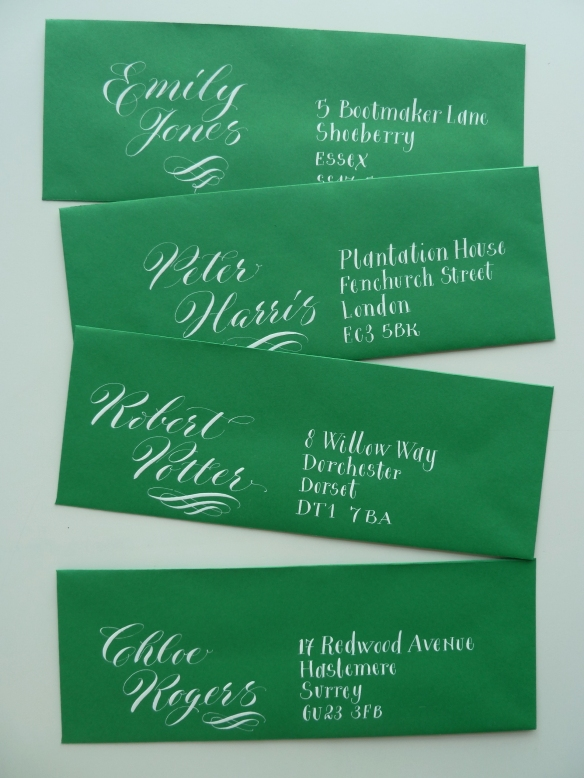 white-copperplate-calligraphy-on-green-envelopes