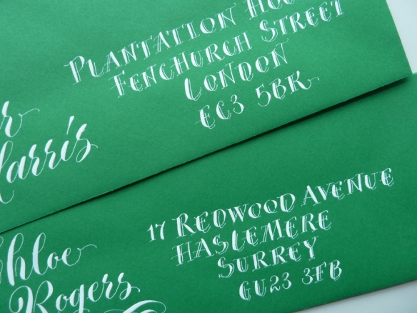 white-pointed-pen-capitals-on-green-envelope
