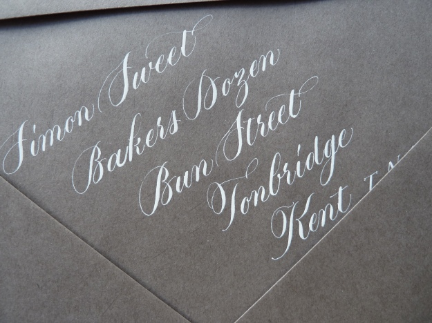 white-copperplate-calligraphy-on-gray-envelope-uk