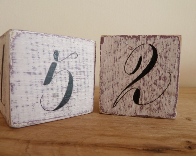 wooden-cubes-with-calligraphy-style-numerals-devon-uk