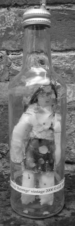 bottle-containing-wax-effigy-with-pins-stuck-in-it-uk