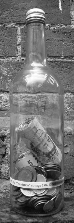 a-bottle-with-a-huge-wad-of-money-in-it-sterling