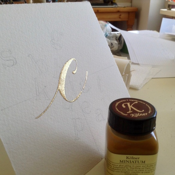 gilding-the-letter-c-work-in-progress-modern-illuminated-letters-uk