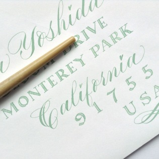 green-copperplate-alternative-envelope-address-with-modern-calligraphy-and-scroll-nib-capitals-for-blog-post-uk