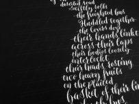 white-modern-calligraphy-for-poem-on-black-paper