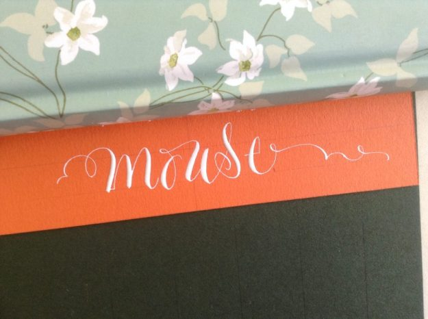 white-modern-calligraphy-on-bright-orange-paper