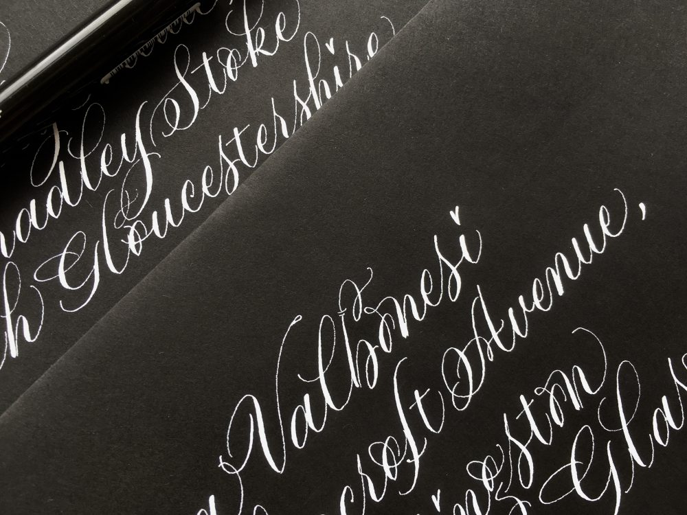 white-copperplate-lettering-on-black-envelopes-for-halloween-uk