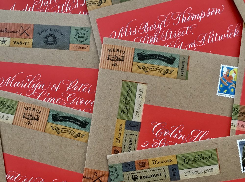 red-christmas-envelope-labels-on-manilla-with-washi-tape-uk