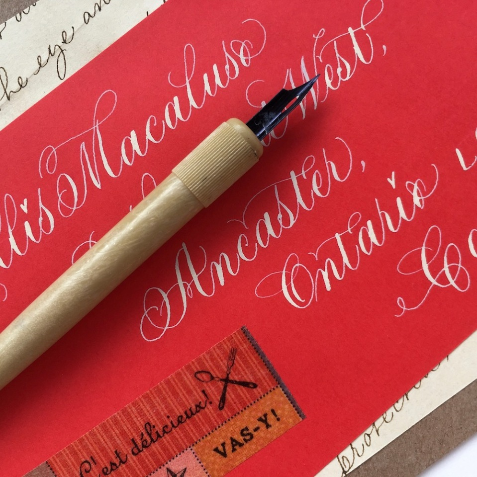 close-up-of-white-calligraphy-lettering-on-red-envelope-label-for-exchange-uk